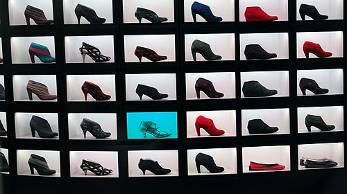 A square grid with black frames and inside are brightly coloured shoes against a white background